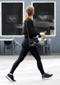 Julianne Hough flaunts her toned figure in black leggings and a crop top during a juice run in Los Angeles