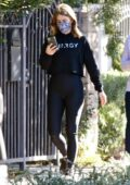Julianne Hough sports black crop top and leggings while out for a hike with her brother Derek Hough in Los Angeles