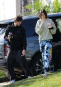 Kaia Gerber and Jacob Elordi stay cozy in sweats as they stop to visit friends in West Hollywood, California