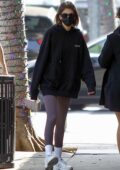 Kaia Gerber looks cozy in a hoodie and leggings while making a juice run in Beverly Hills, California