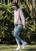 Kaia Gerber sports a tie-dye hoodie and teal leggings while out walking her dog with Jacob Elordi in Santa Monica, California