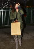 Katharine McPhee covers her baby bump underneath a green jacket during a dinner outing in Santa Monica, California