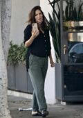 Katharine McPhee is all smiles as she chats on her phone while visiting a salon in Los Angeles