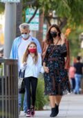Katharine McPhee looks pretty in a printed dress while out shopping with David Foster and his Granddaughter in Los Angeles