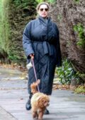 Kelly Brook goes make up free as she takes her pooch Teddy out for a walk in London, UK