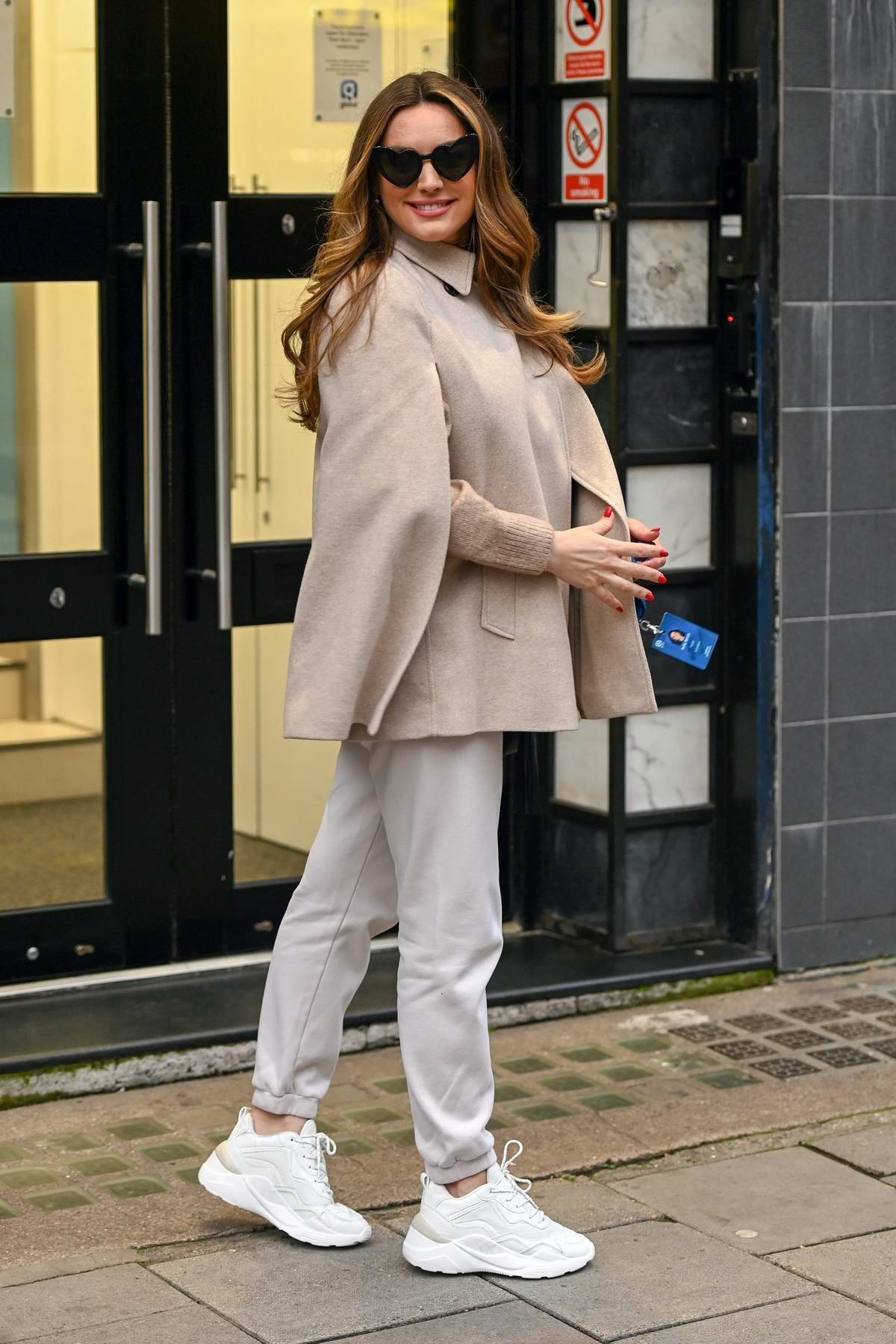 Kelly Brook shares a bright smile as she arrives at Global Radio in London, UK