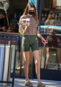 Kendall Jenner flaunts her slender figure in a tee and legging shorts during a coffee run in Beverly Hills, California