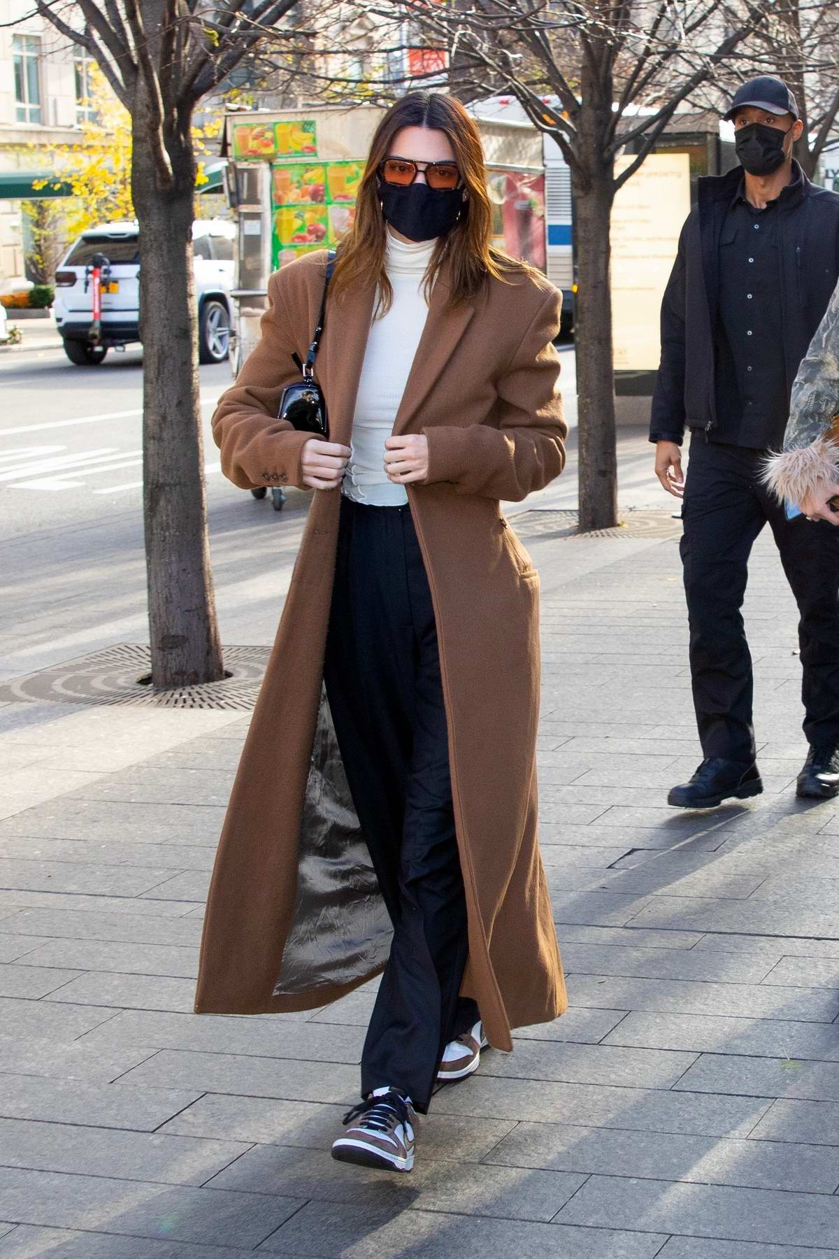 Kendall Jenner looks chic in a beige overcoat as she grabs lunch with Bella Hadid in New York City