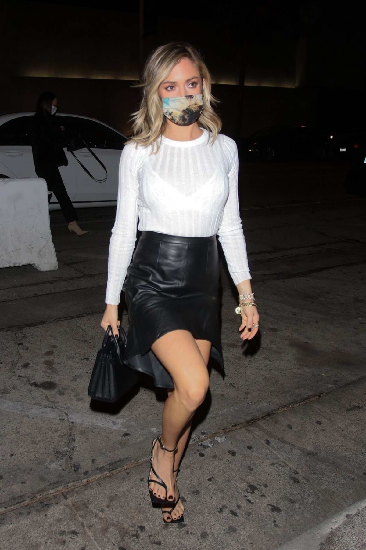 Kristin Cavallari dons a white top and black leather mini skirt while out for dinner at Craig's in West Hollywood, California