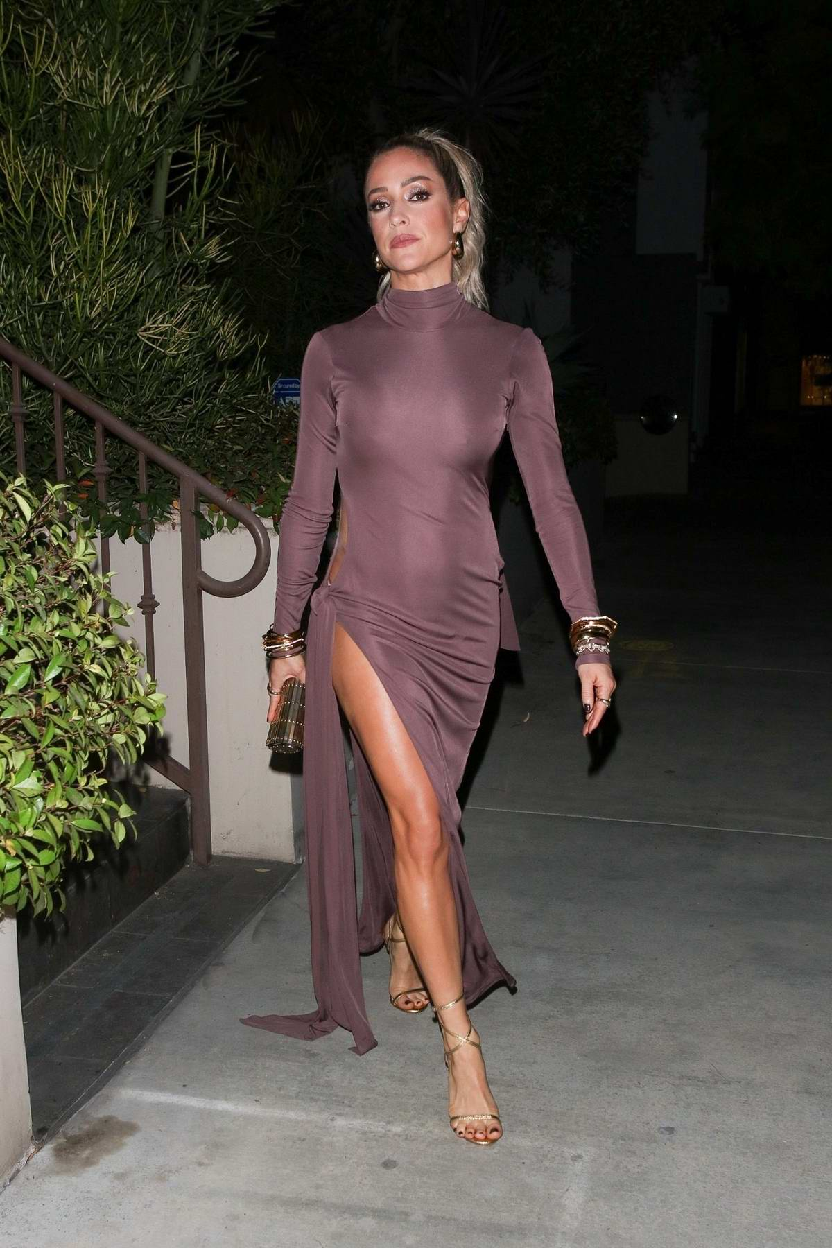 Kristin Cavallari flaunts her legs in a form-fitting dress while heading to the 2020 American Music Awards in Los Angeles