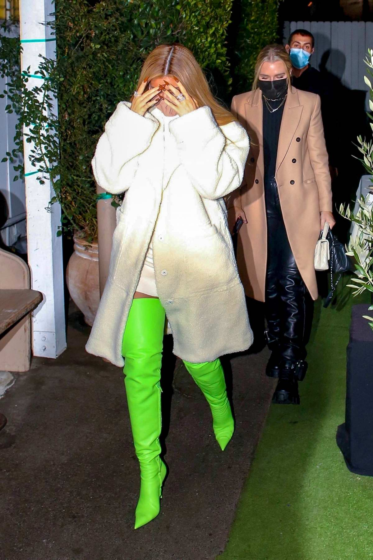 Kylie Jenner dazzles in bright green thigh-high boots as she arrives for dinner with friends in Santa Monica, California