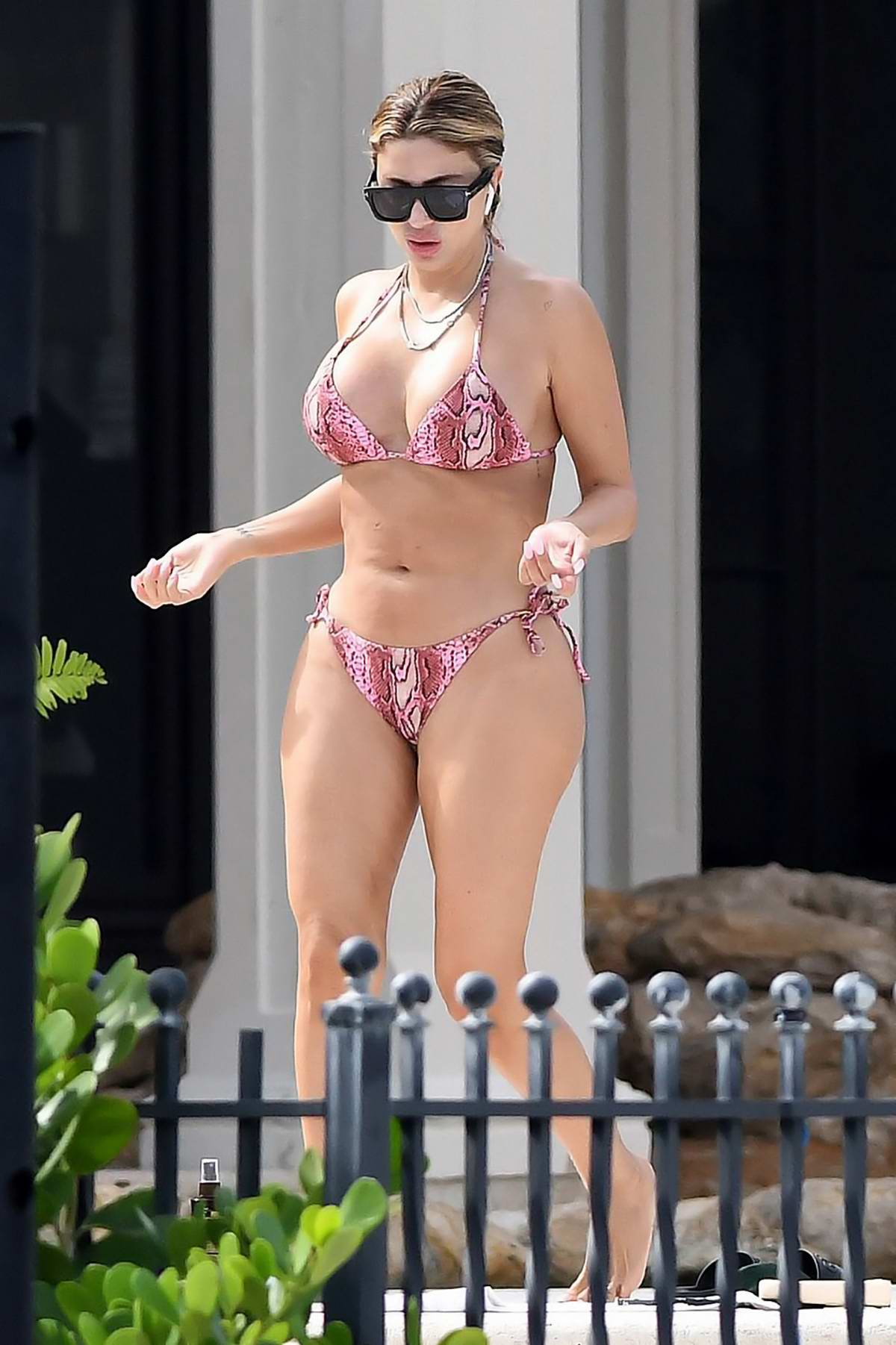 Larsa Pippen soaks up the sun in a pink snakeskin print bikini while enjoying a day in Fort Lauderdale, Florida