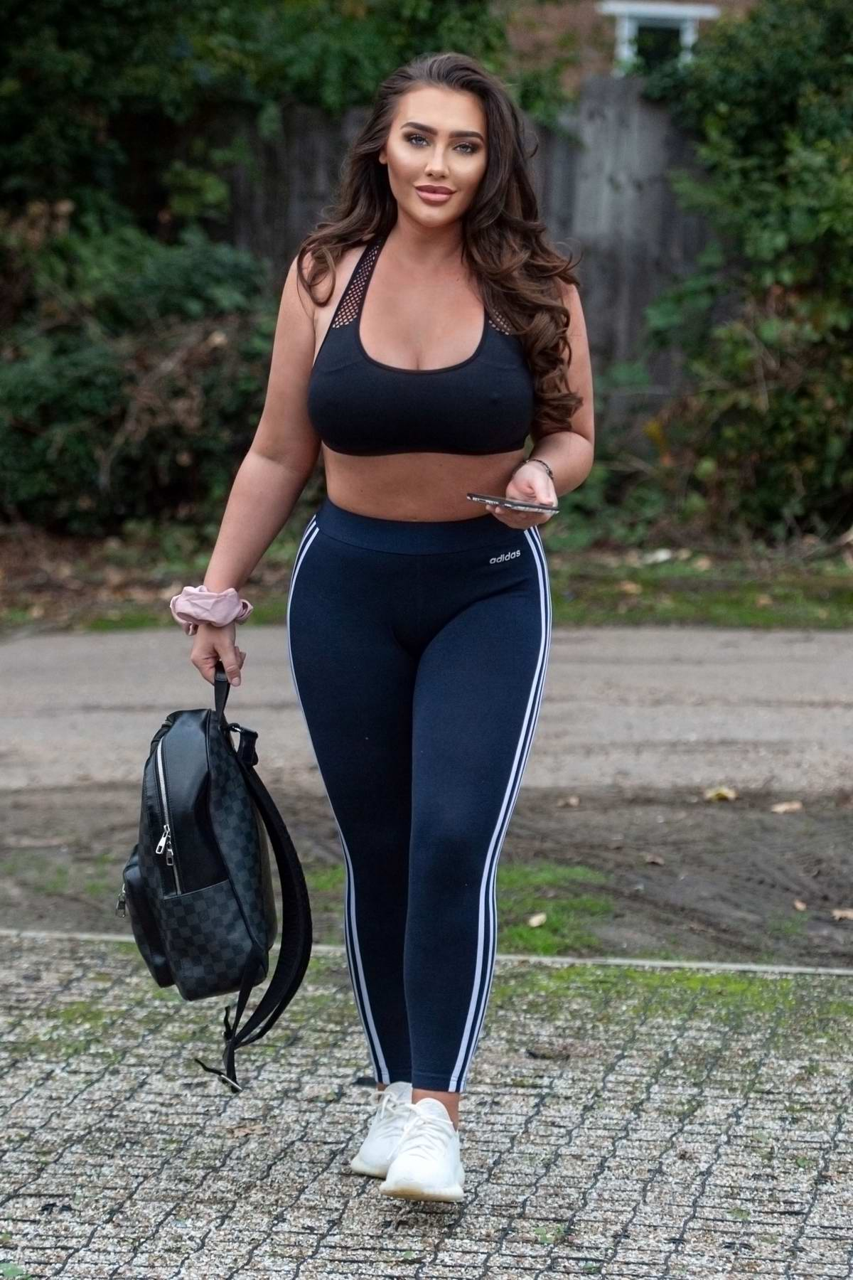 Lauren Goodger shows off her midriff in a crop top and leggings out in Chigwell, Essex, UK