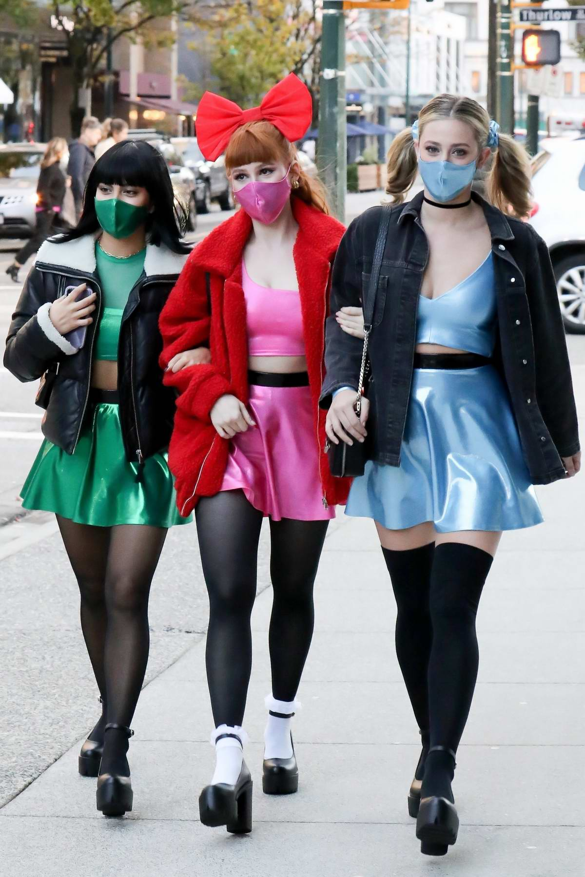 Lili Reinhart, Camila Mendes and Madelaine Petsch dress up as The Powerpuff Girls for Halloween as they step out in Vancouver, Canada