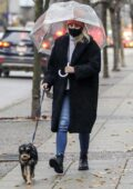 Lili Reinhart carries a clear umbrella as she takes her dog out for a walk in Vancouver, Canada