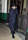 Lily James hides from the cameras while enjoying a night out with Dominic Cooper in London, UK