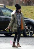Lucy Hale bundles up in fur-lined puffer jacket while walking her dog Elvis in Upstate New York