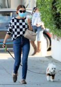 Lucy Hale looks cute in a checkered sweater and skinny jeans while out with her dog Elvis in Los Angeles