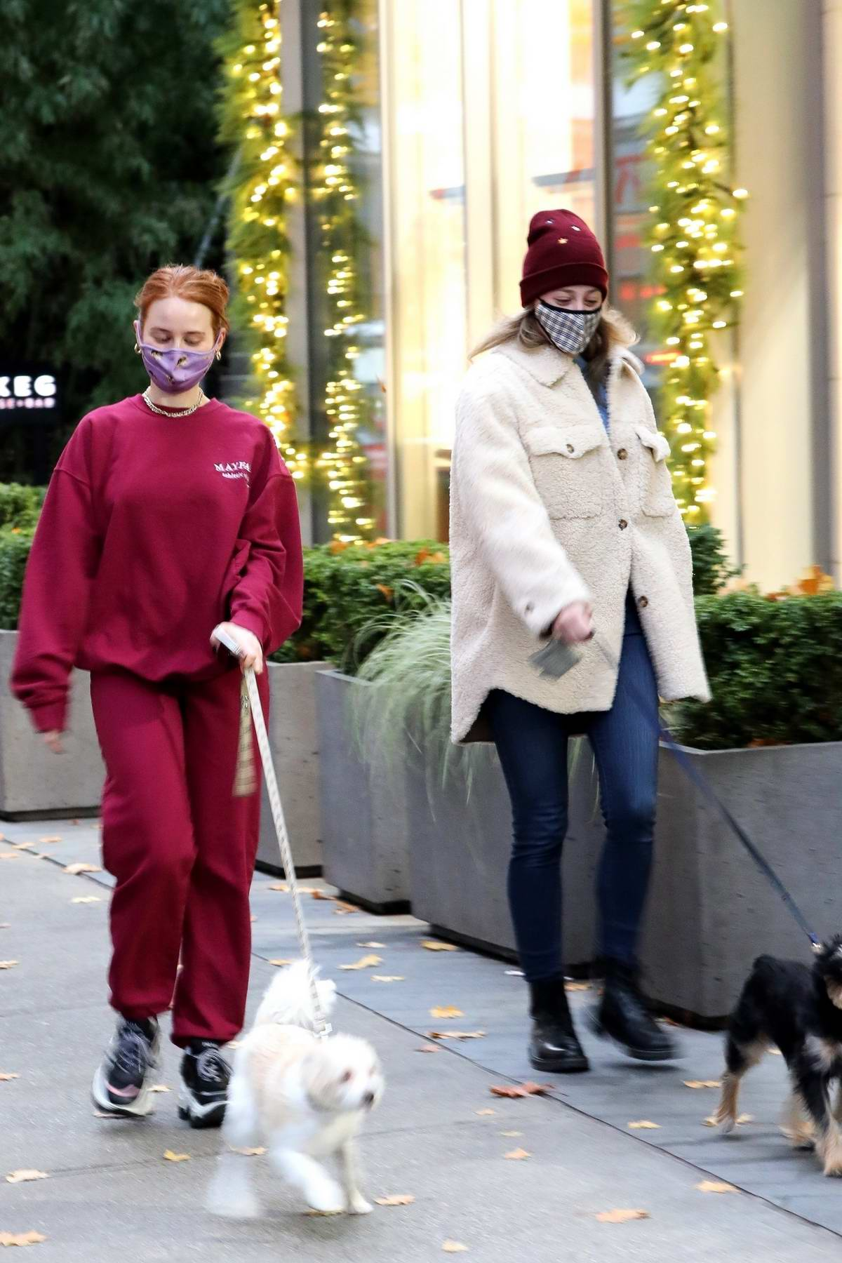 Madelaine Petsch and Lili Reinhart step out to walk their dogs in Vancouver, Canada