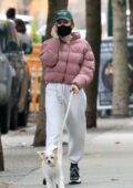 Madelaine Petsch bundles up in a puffer jacket and sweatpants while walking her dog in Vancouver, Canada