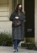 Mandy Moore seen wearing a warm coat while visiting an office in Los Angeles