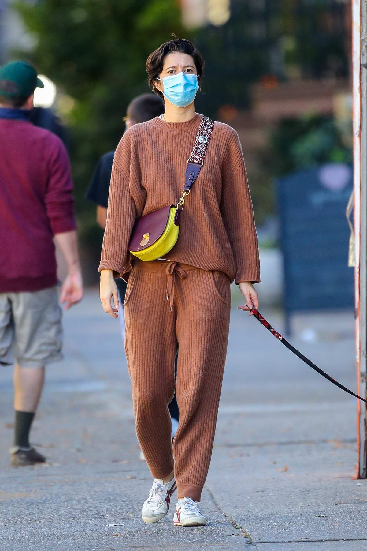 Mary Elizabeth Winstead looks comfy in rust-colored sweats while out walking her dog in West Village, New York