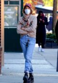 Maya Hawke looks cozy in a sweater while out for lunch with a friend in Manhattan's West Village, New York City