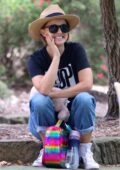 Natalie Portman kicks back to enjoy the views while visiting a park with her family in Sydney, Australia