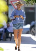 Natalie Portman wears a blue shirt and denim short as she takes her kids to the park in Sydney, Australia