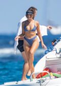 Olivia Culpo sets pulses racing in a blue denim bikini while sailing off the coast of Cabo San Lucas, Mexico