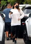 Olivia Munn sports an oversized white sweatshirt and black leggings as she leaves her gym after a workout in Los Angeles