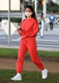 Olivia Munn sports red sweats as she picks up her friends in her Tesla before heading to Santa Monica, California