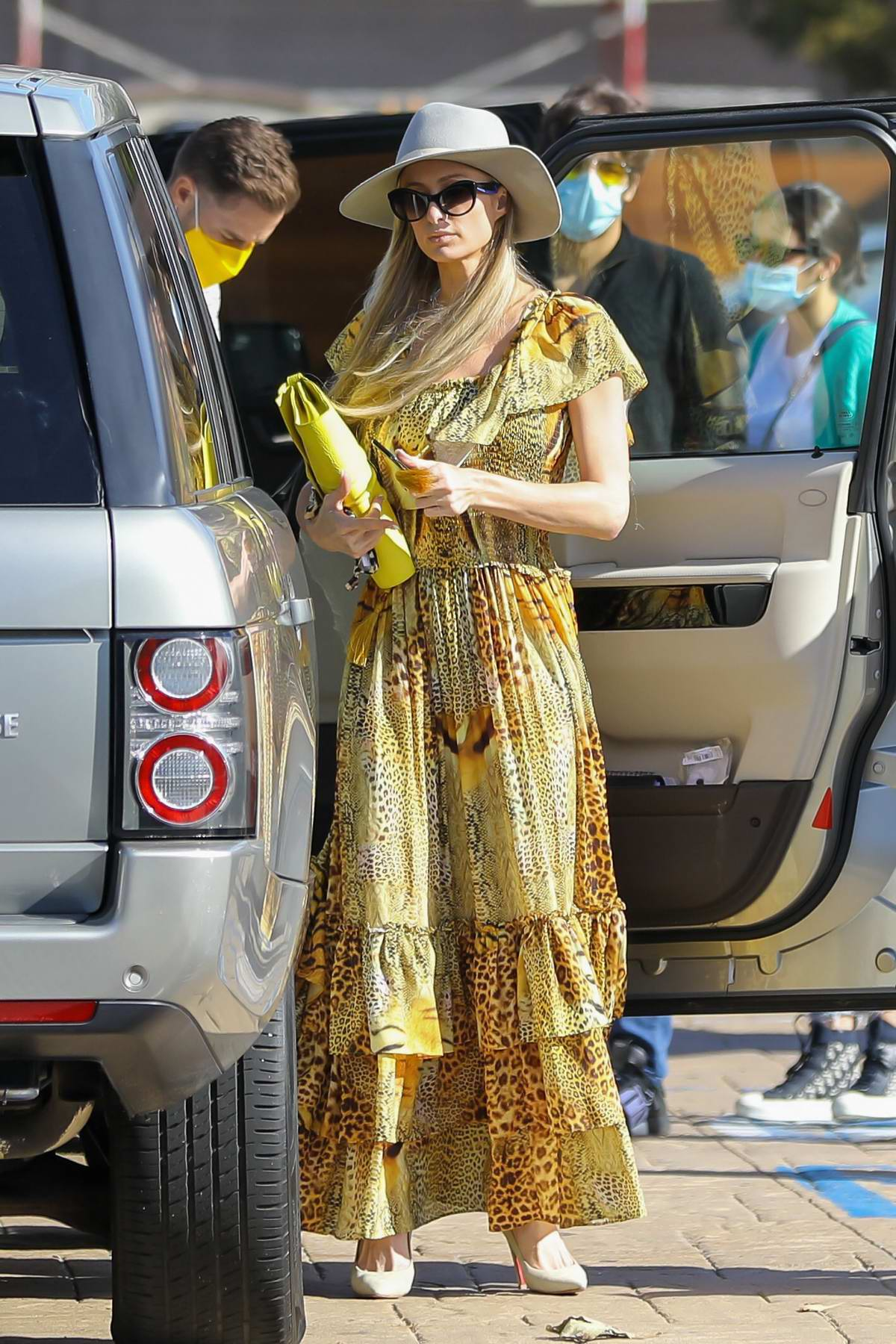 Paris Hilton looks great in a flowing yellow dress while out in Malibu, California
