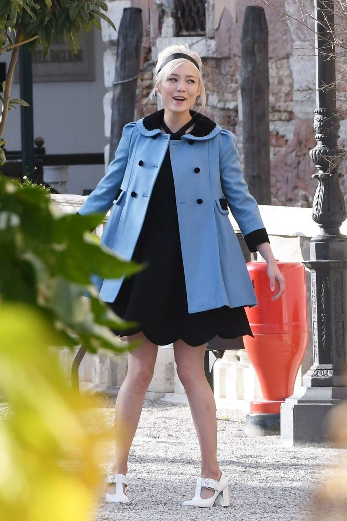 Pom Klementieff spotted in a garden while making videos on her mobile phone with Simon Pegg in Venice, Italy