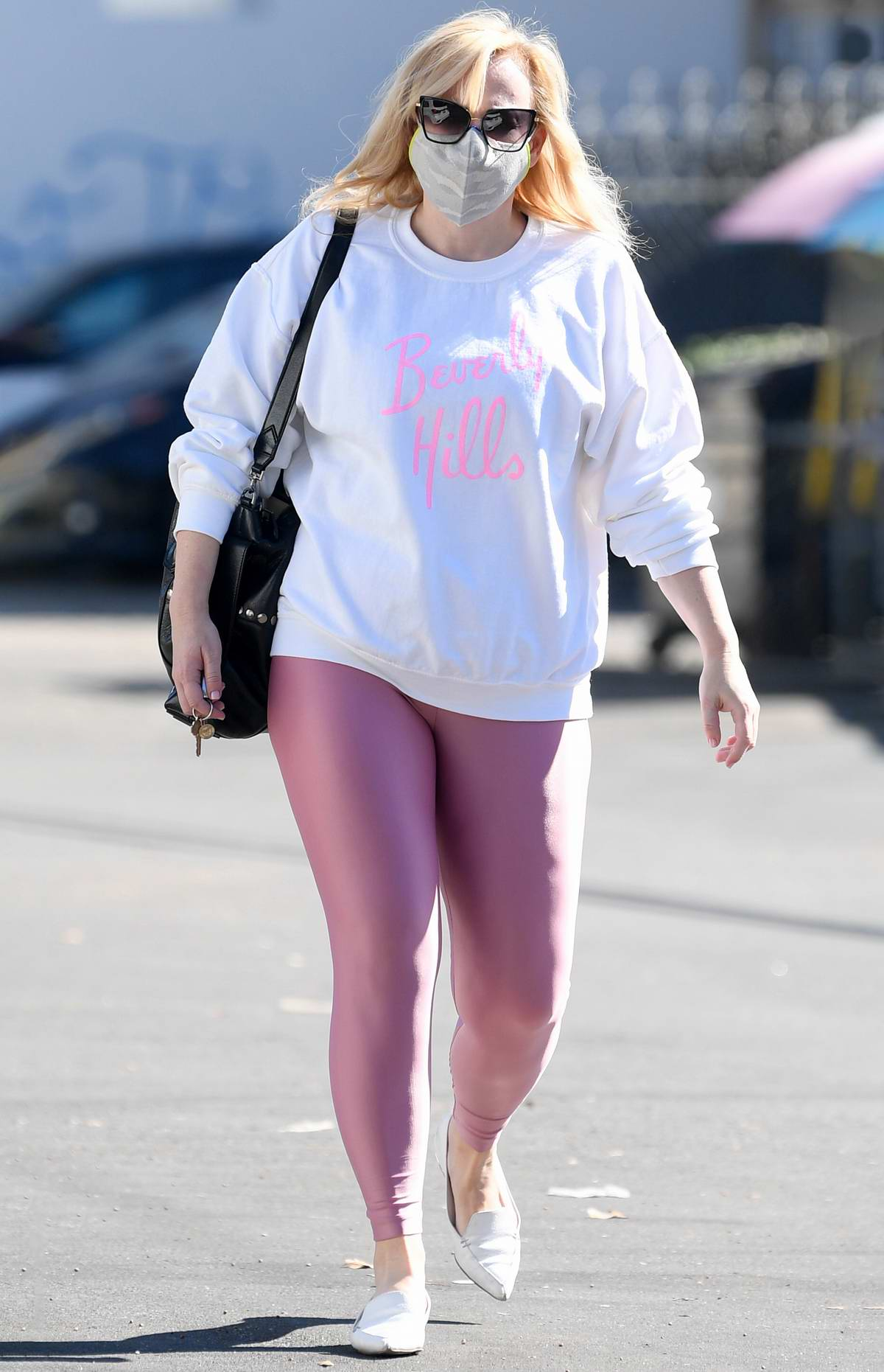 Rebel Wilson dons a white sweatshirt and pink leggings while stepping out in Los Angeles