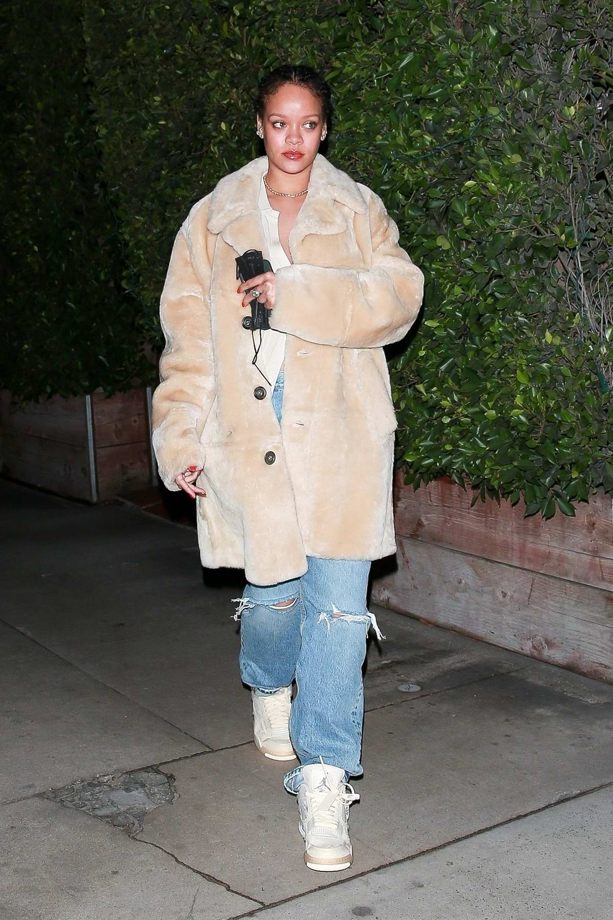 Rihanna looks cozy in a fur coat as she exits Giorgio Baldi after dinner in Santa Monica, California
