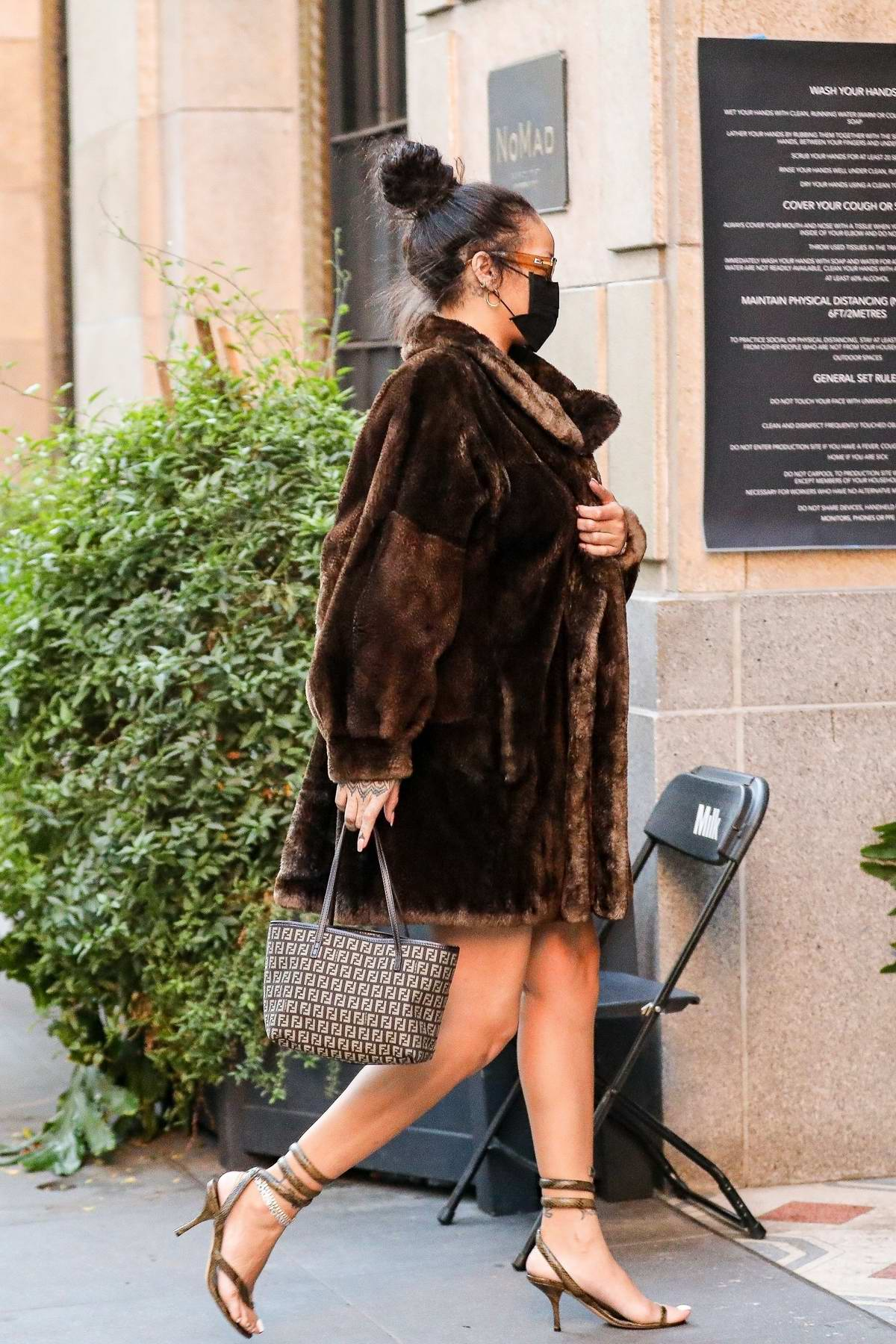 Rihanna puts on a stylish display in a fur coat as she arrives at NoMad Sky Bar in Los Angeles