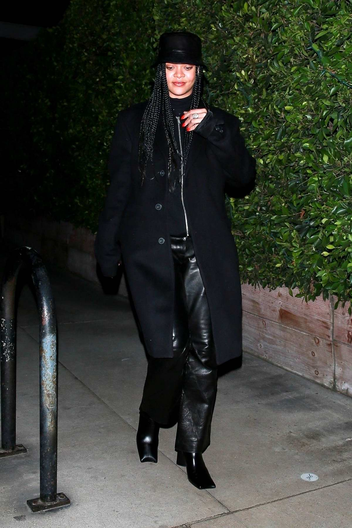 Rihanna spotted in all-black ensemble while slipping out after grabbing a quick bite in Santa Monica, California