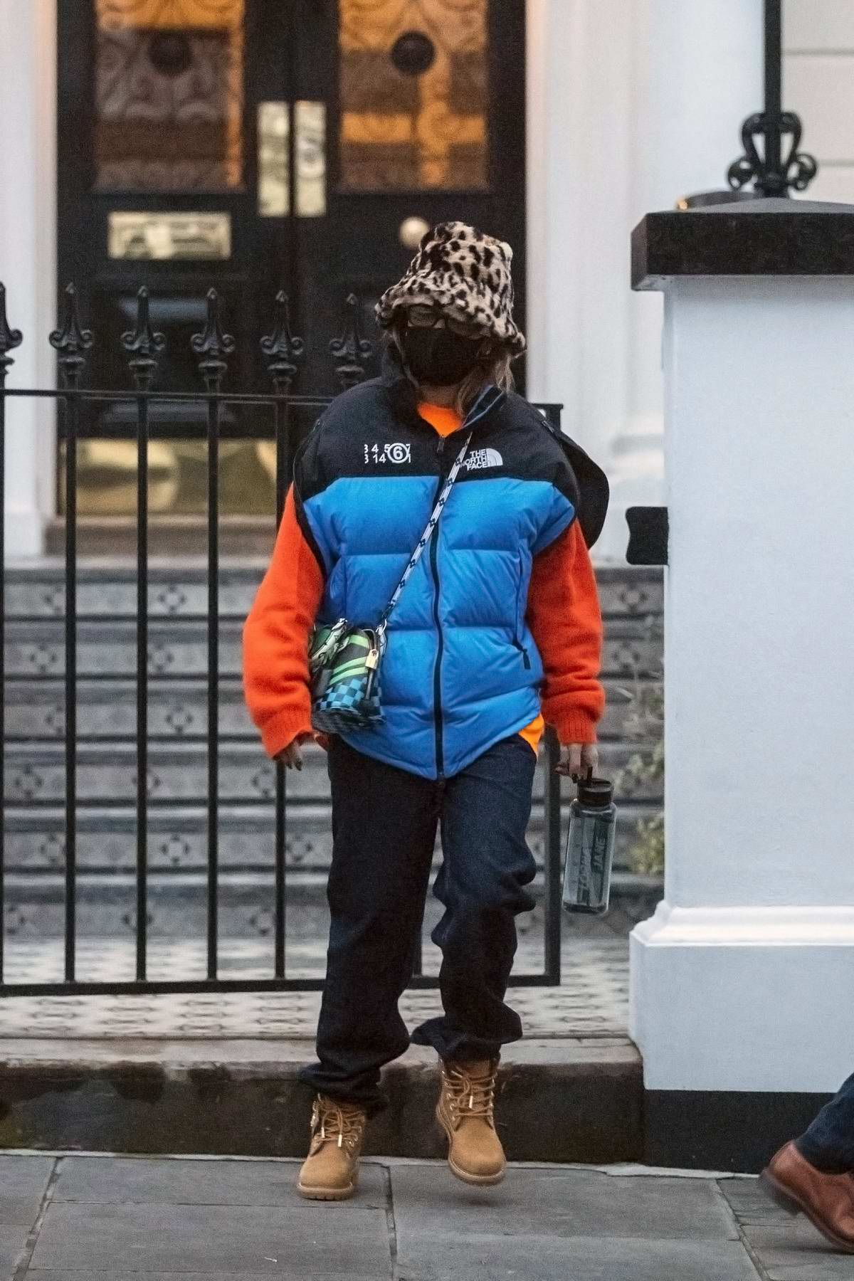 Rita Ora bundles up in colorful winter clothing as she steps out on a chilly day in London, UK