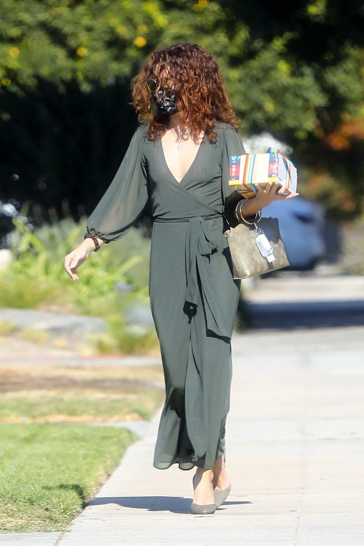 Sarah Hyland looks great in an olive green wrap dress as she attends a friend's birthday party in Los Angeles