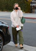 Sarah Paulson wears teddy jacket and sweatpants as she leaves the Balayage hair salon in Beverly Hills, California