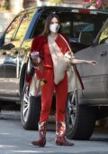 Scout Willis carries her dog in a sling pouch while visiting a friend wearing all-red in Los Angeles