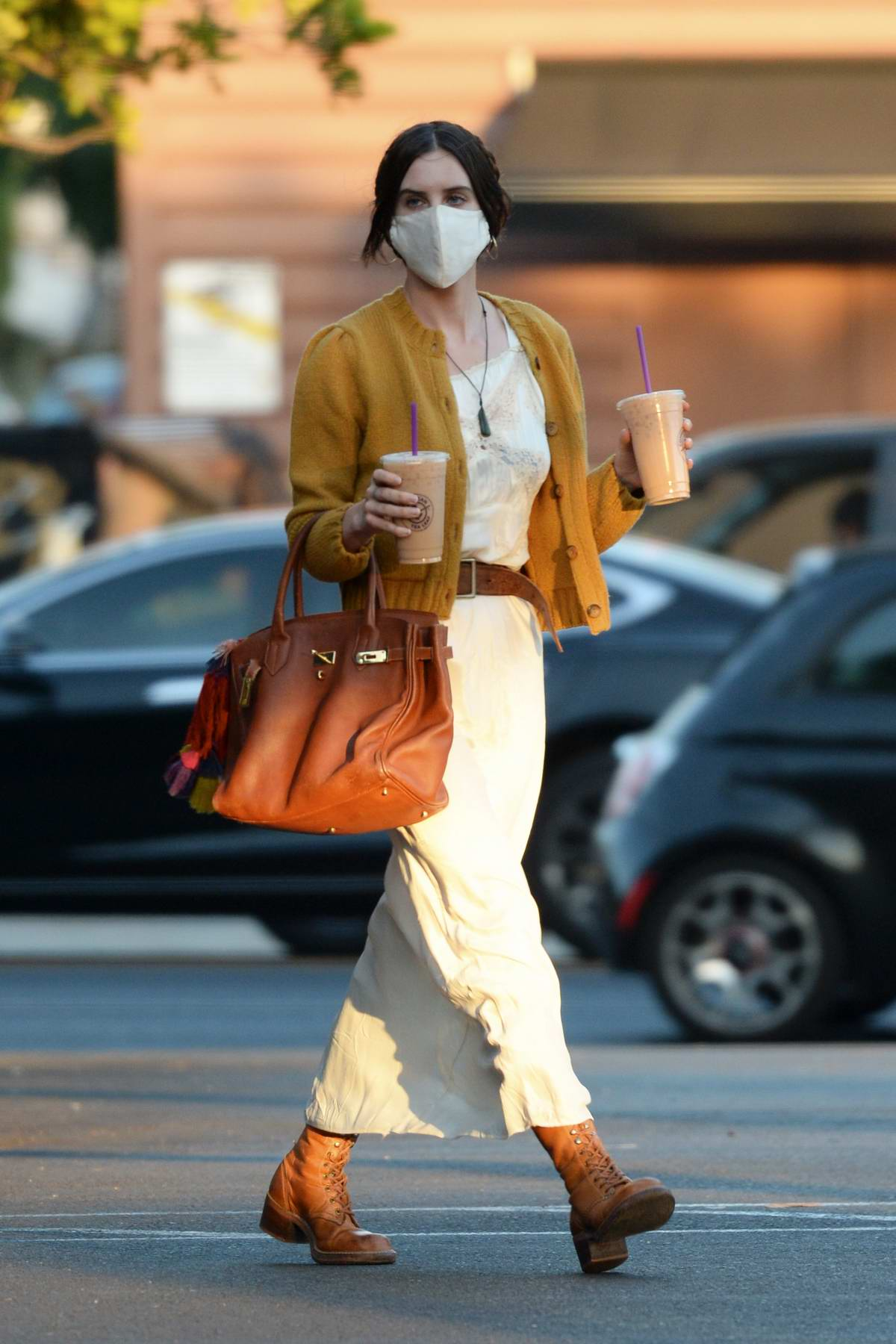 Scout Willis wears a white dress with mustard yellow cardigan while making a coffee run in Los Angeles