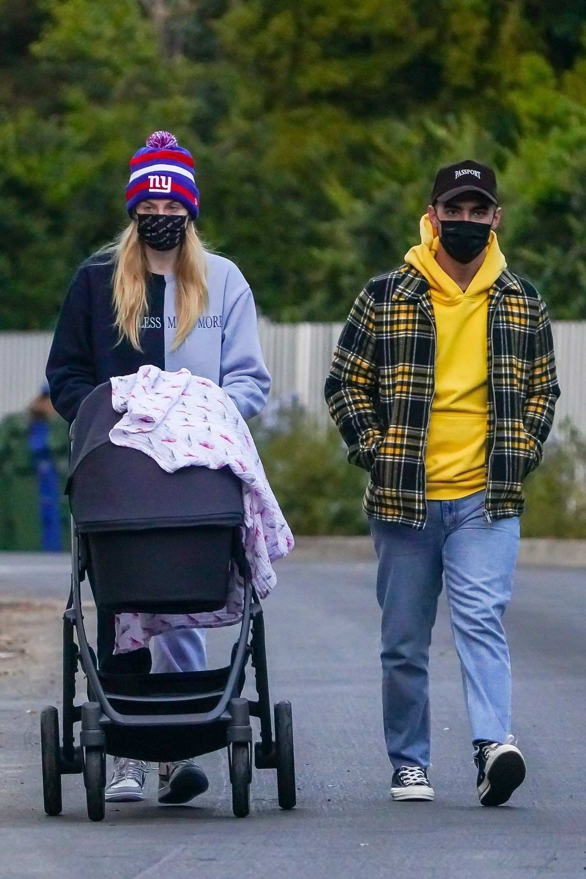 Sophie Turner and Joe Jonas step out for an afternoon stroll with daughter Willa on a chilly day in Los Angeles