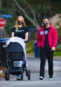 Sophie Turner and Joe Jonas take their daily walk with their daughter around their neighborhood in Los Angeles