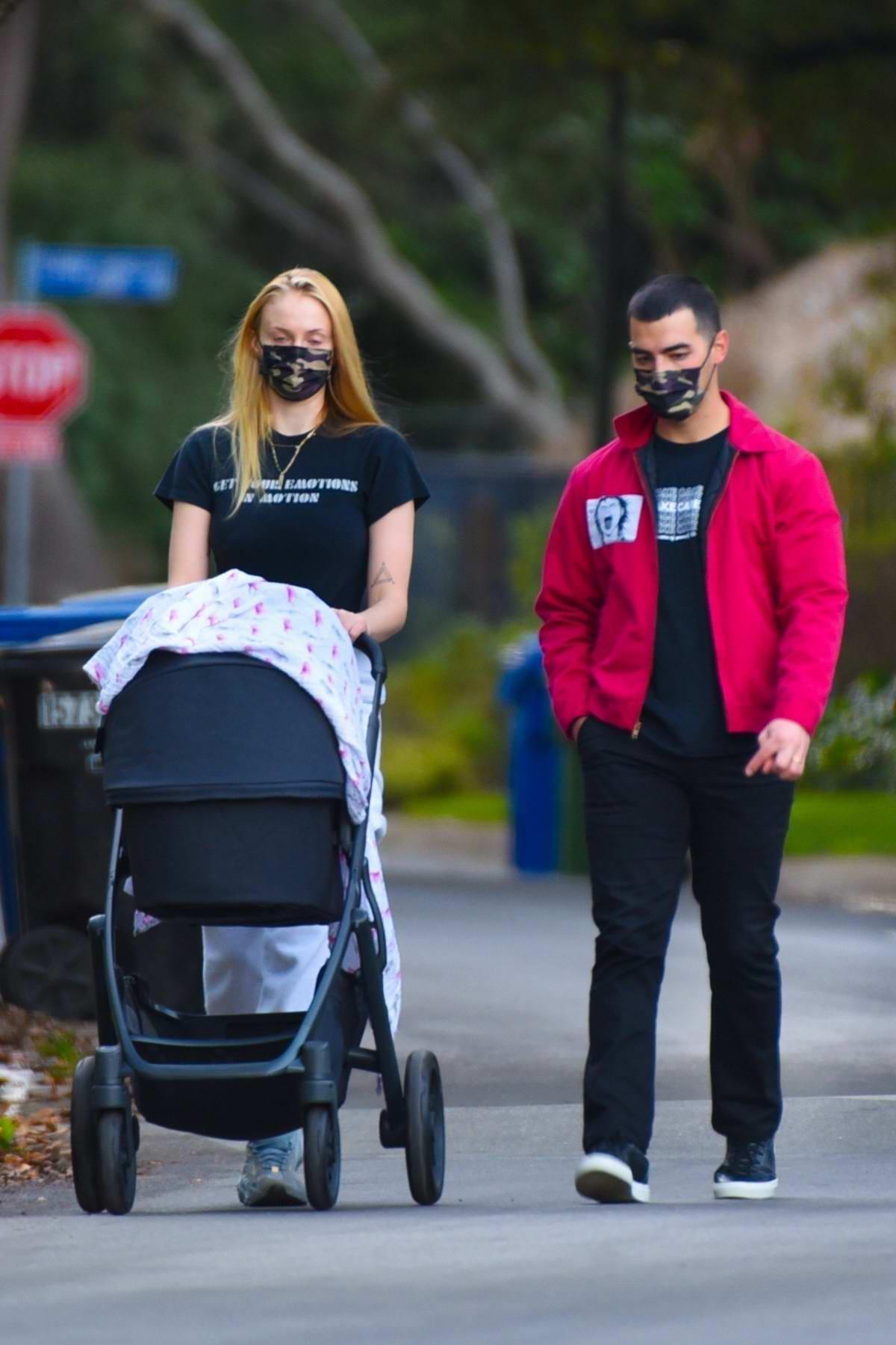 Sophie Turner and Joe Jonas take their daily walk with their daughter around their neighborhood in Los Angeles