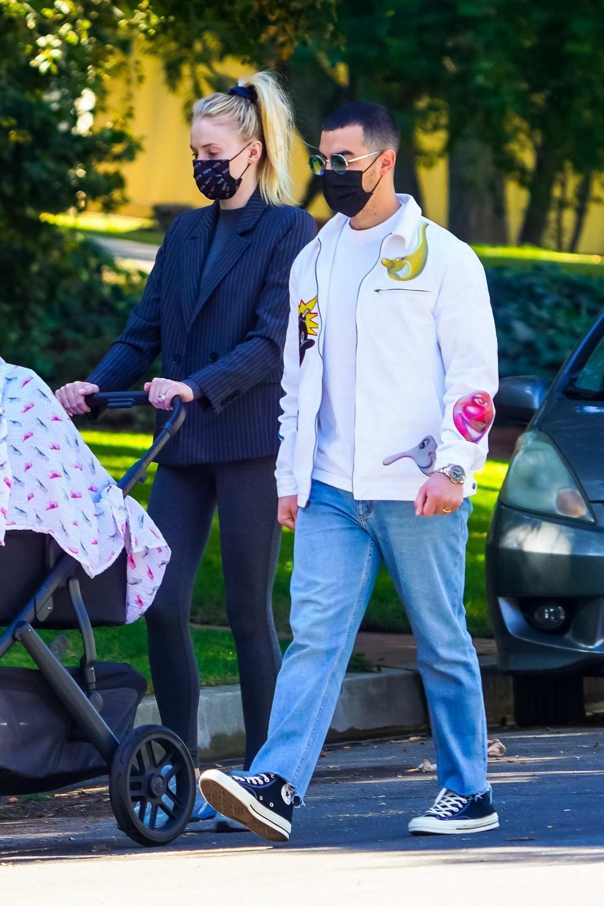 Sophie Turner and Joe Jonas take their daughter Willa out for a walk in Los Angeles