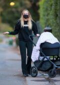Sophie Turner goes out for an evening stroll around the neighborhood with her daughter Willa in Los Angeles