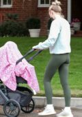 Sophie Turner sports sweatshirt and leggings while out on a stroll with her daughter in Los Angeles