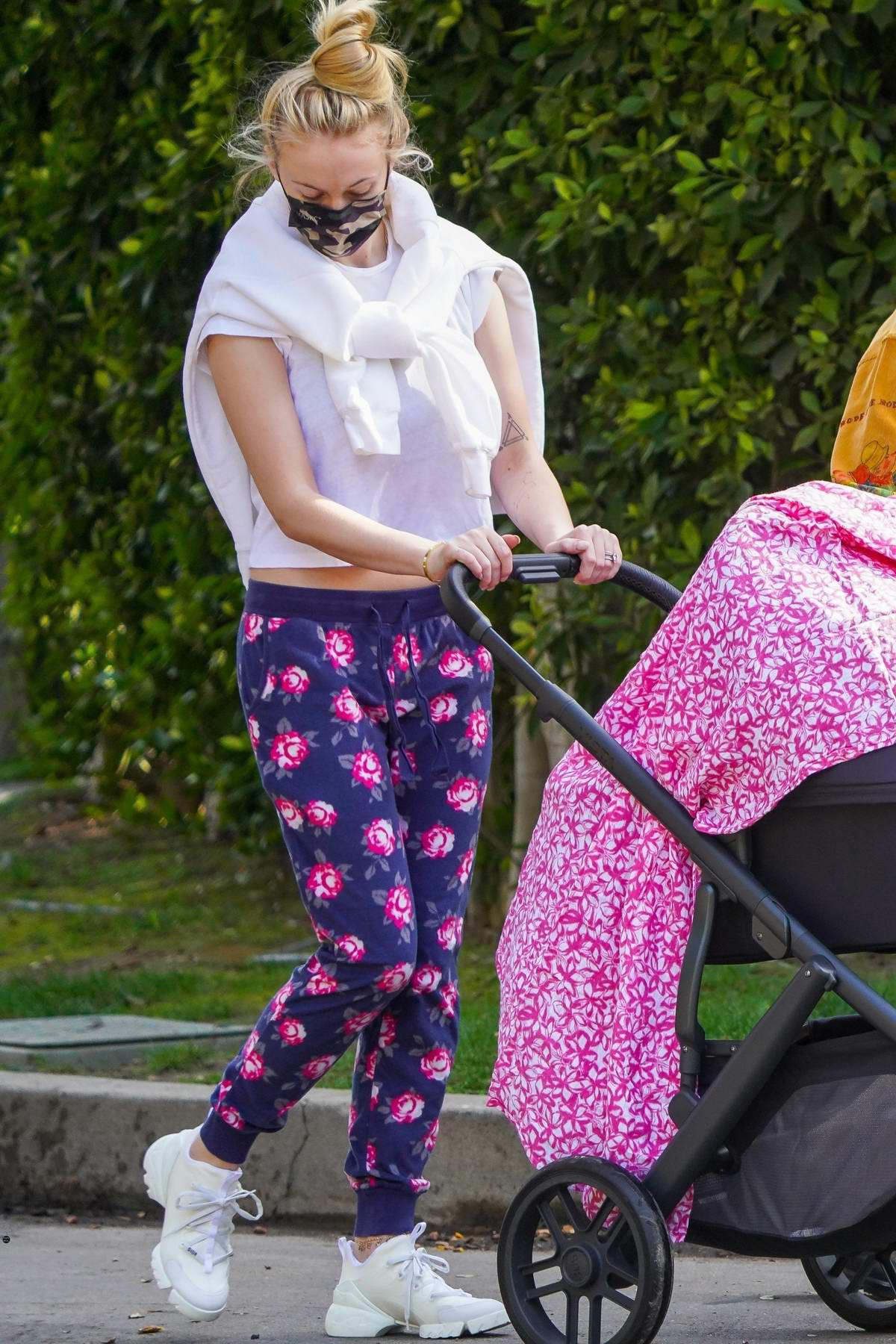 Sophie Turner steps out in cute pajamas while taking a walk with Joe Jonas and their baby in Los Angeles
